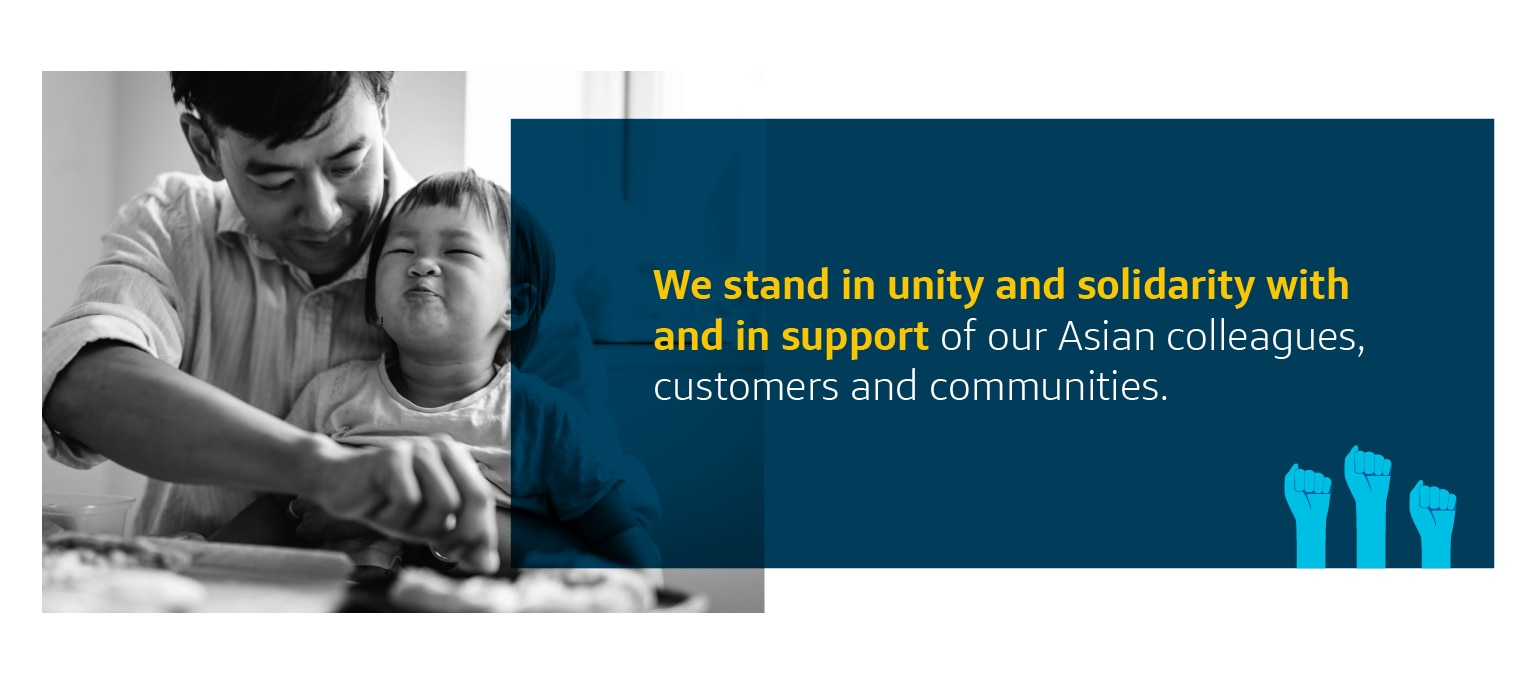Asian parent with young child sitting at table_We stand in unity and solidarity with and in support of our Asian colleagues, customers and communities