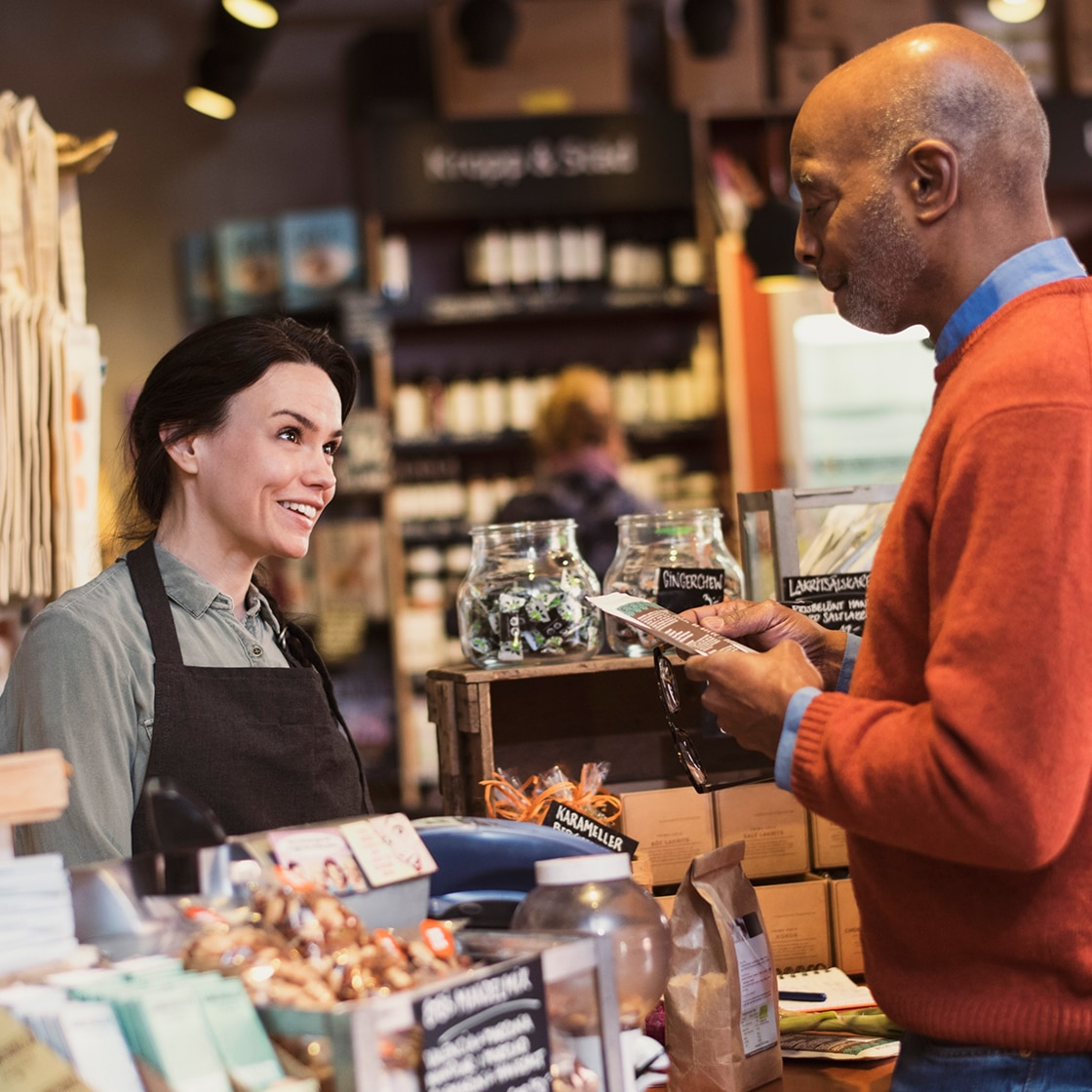 man making a purchase